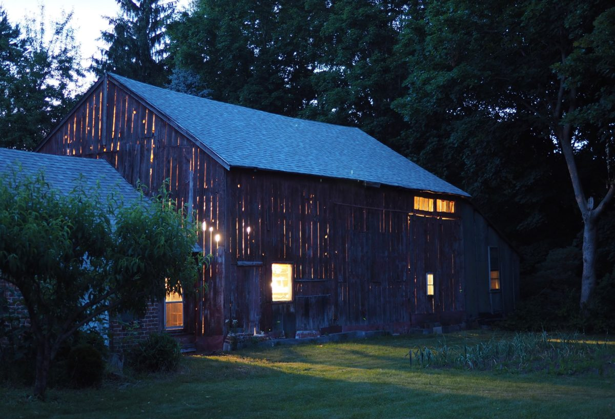Barn at twilight, lit from within